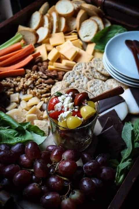 A cheese board with sweet and savory foods
