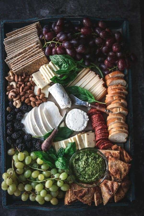 A cheese board featuring spreads